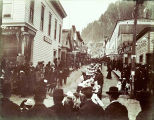 Decoration Day, procession going up Seward St. Juneau, Alaska, 1899.