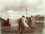 Fishermen on pier at Juneau, 1899.
