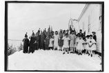 [Children in costume for the school play standing outside of school next to ANB Hall, ca. 1928.]