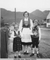 Woman and two children wearing Norwegian dress.