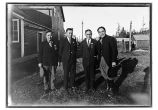 [Portrait of four men standing outside of cannery; Billy Williams, Max Italio, and Peter Dick.]