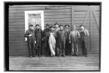 [Group portrait of workers, probably outside of cannery.]