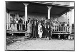 [Group portrait on porch of ANB Hall.]