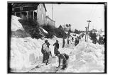 [Group of men shoveling snow from sidewalk.]