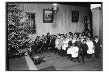 [Group of children by Christmas tree.]