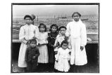 [Group portrait of two women and four children.]