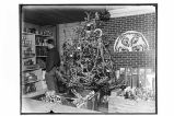 [Interior view of store decorated for Christmas.]