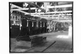 [Interior view of the cannery showing the retorts for cooking the cans of salmon.]