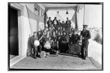 [Group portrait of Salvation Army members. Band in the front row.]