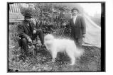 [Two men and a dog.]