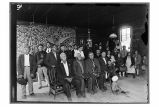 [Interior view of Thunderbird House with group of people gathered for a meeting.]