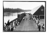 [Fourth of July foot races on cannery dock.]
