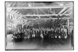 [Interior view of the cannery, with workers assembled for group portrait.]