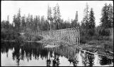 [Trestle in construction with pile driver follows shoreline.]