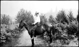 [Unidentified man on horseback.]