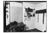 [Interior view of room with the radio operator's equipment on table.]