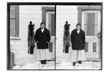 [Mrs. Jenny Kardeetoo in front of Whale Killer House, with a black fox fur hanging beside her....