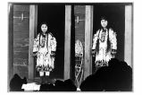 Maggie Jackson (Left side) and Susie Jackson (right side), wearing ceremonial garments; the shirts...