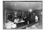 [A party in the mess hall of the cannery.]