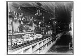 [Interior view of Libby, McNeil, and Libby Store, with three men behind the counter.]