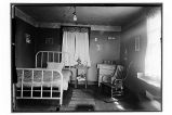 [Interior view of bedroom, perhaps a room in the clinic.]