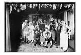 [A winter party in the home of white folks. Mark Matthews in Scottish attire.]