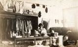 [Interior of Dry Goods and Millinery, Iditarod, 1914 and young woman.]