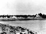 [Kodiak homes viewed from beach with water foreground. 1908?]