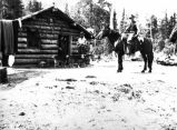 [George C. Hazelet on horse in front of government barn on trail to Copper River between Tiekel...