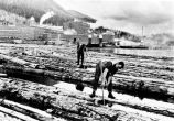 [Pond men on floating logs, Ketchikan Pulp Mill.]