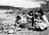 Eskimo women cutting fish on beach, Tununak.