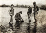 [Four men panning gold, Manneluk River.]