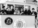 [Coast Guard Bering Sea Patrol officers and crew, and puppies on the Hermes.]