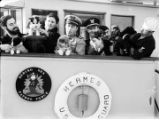 [Coast guard officers and crew, and puppies aboard the Bering Sea Patrol Force boat, Hermes.]