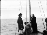[Woman and two men? on a sail boat]