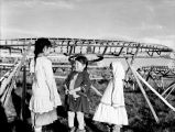 [Detail of ASL-MS236-266-25: [Three girls by umiak frames. At fish camp.]