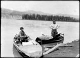 Spok and ex-telegraph operator at Swede Creek [in canoes]