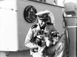 [Coast Guard officer, three puppies, Bering Sea Patrol boat, Hermes.]