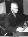 An informal portrait of General Simon B. Buckner, Jr. at his desk. Fort Richardson, Alaska,...