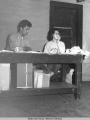 Alfred Ketzler, Chairman of Tanana chiefs, and Wilma Ketzler, secretary [seated behind a table.]...