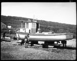 GETTING THE FISH BOAT READY FOR THE SUMMER, CHIGNIK, 1940.