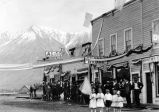 [Unidentified Alaska town (maybe McCarthy); business sign:  Alaska House 4th of July celebration.]