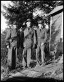 [Portrait of three men in military uniform, standing outdoors.]