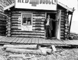 "Red Cross Drug Co. ""Dr. DeNorton, Phys. & surgeon Gerdy City Innoko, Alaska on his porch."