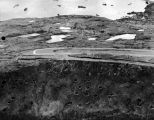 End of Jap runway showing bomb craters. Kiska.