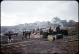 Belkofski, unloading the barge - village in distance - Greek Church.