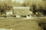 [Nugget Creek Power plant with water pouring out.]