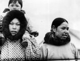 1936 [?]. [Two native women with facial decorations, and a baby.]