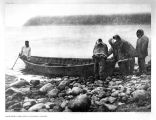 Five men.  [Launching the boat - Diomede Island.]