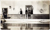 [Three men getting ready to dive into the pool at the Treadwell Natatorium.]